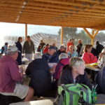 Guests gathering in the outdoor pavillion