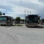 Two RVs parked in their sites