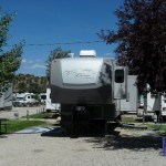 A fifth-wheel parks in its site